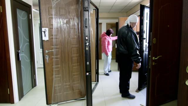 Customers looking for new door in the doors store showroom video