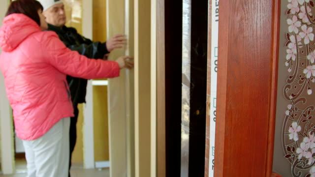 Customers looking for new interior door in the doors store showroom video