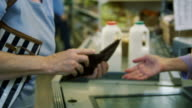 Customers paying for their shopping in a Supermarket till video