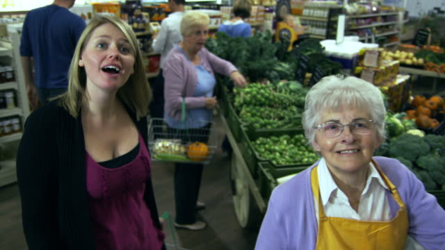 Customers shopping in a Supermarket video