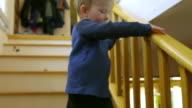 Cut child runs down some house steps video