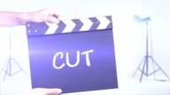 Cut film slate in a studio shot background video