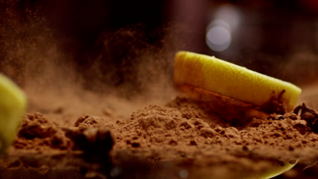 Cut Lemon Falling. Splashing Into cacao. Slow motion. Shot on RED EPIC Cinema Camera. video