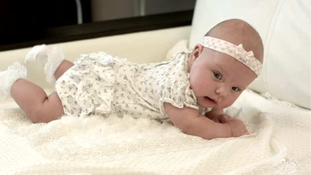 Cute 3 months baby lying down on a blanket video