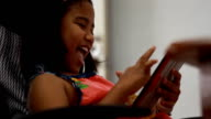 Cute African girl play tablet in coffee shop video