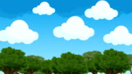 Cute and Puffy Cartoon Clouds Hovering in a Blue Sky Above the Forest Trees video
