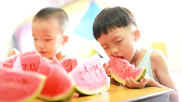 Cute Asian baby eating watermelon video