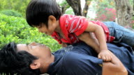 Cute Asian Boy Kisses Dad At The Park video