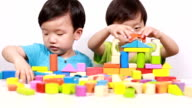 Cute asian Children playing with blocks video