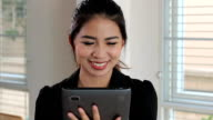 Cute Asian Female Office Working Laughing With Tablet video