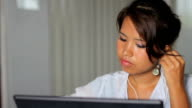 Cute Asian Girl Listens To Music At Work video
