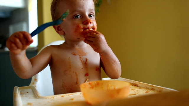 Cute baby boy eating lunch video