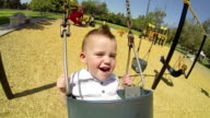 Cute Baby Boy On Swing At Park In Summer video
