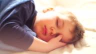 Cute baby boy sleeping and wake up video