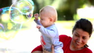 Cute Baby Catching Soap Bubbles video