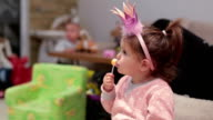 cute baby girl eating licking a lollipop video