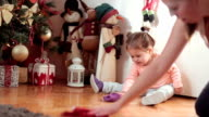 cute baby girl , toddler , is helping her mother to clean floor video