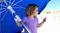 cute baby singing in blue parasol beach video