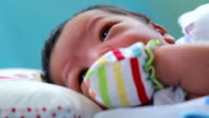 Cute baby sleeping and dreaming video