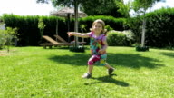 cute baby two years running and dancing in garden slow video