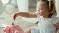 cute baby with a spoon eating birthday cake video