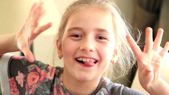 Cute beautiful girl  making funny faces video