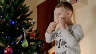 Cute boy eat gingerbread man video
