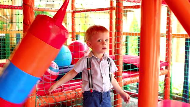 Cute boy having fun at entertaining center. video