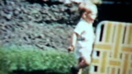 Cute Boy Playing With His Grandmother Outside-1963 Vintage 8mm film video