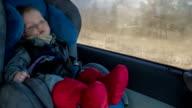 Cute boy sit in car chair video