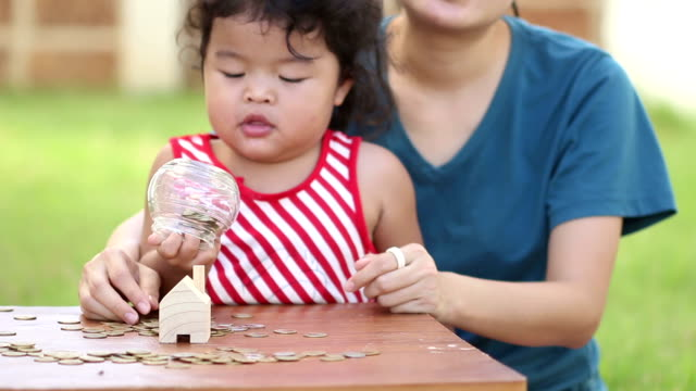Cute boy with mother learn to count money video