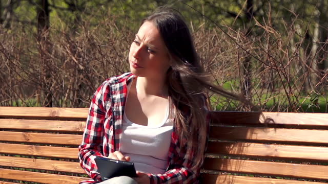 Cute brunette girl using digital tablet video