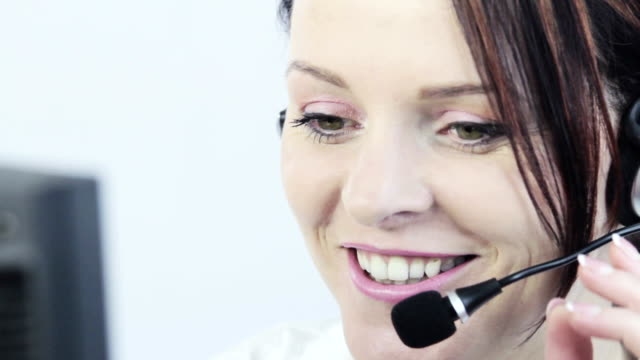 Cute business customer service woman smiling. video