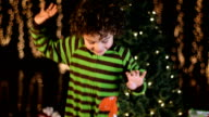 Cute Child Excitedly Dances In Front of Christmas Tree video