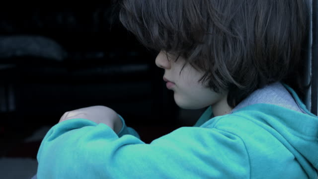 Cute child looking dramatic at the camera. Depressive mood video