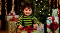 Cute Child Opens Christmas Present video