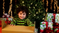 Cute Child Pulls Tissue From Christmas Present video
