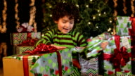 Cute Child Unwraps Christmas Present video