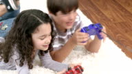 Cute children playing video games lying on the floor video