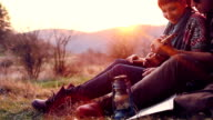 Cute couple have fun together on a hike picnic video