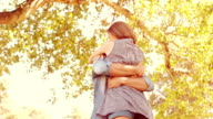 Cute couple hugging in the park video
