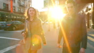 Cute couple in big city talk as they walk together video