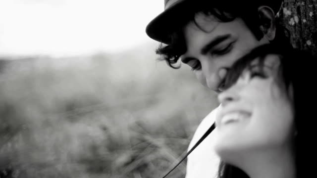 Cute couple on black and white sitting together video