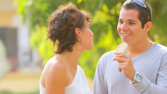 Cute couple share ice cream video