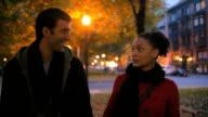 Cute couple stroll through park video