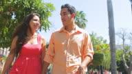 Cute couple walking in city video