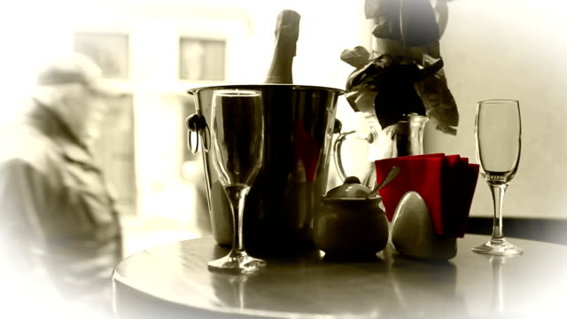 Cute dating scene. Champagne in bucket with glasses. video