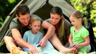 Cute family camping in the countryside video