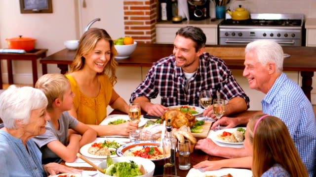 Cute family having a nice dinner at home video