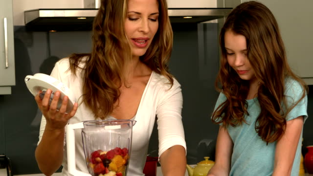 Cute family preparing a smoothie video